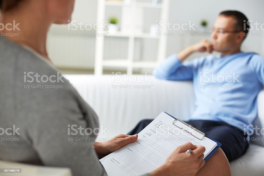 Man at psychologist stock photo
