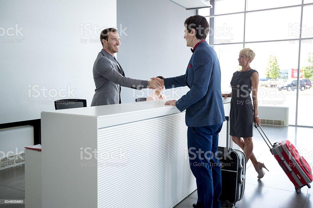 Man at reception hall stock photo