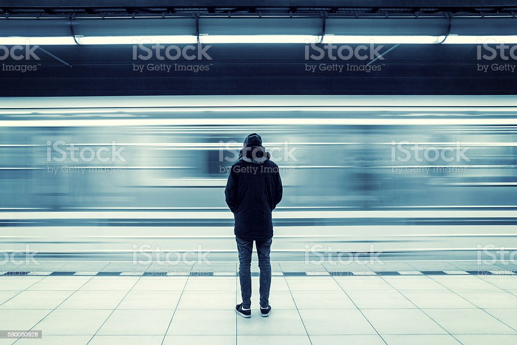 Man at subway station stock photo