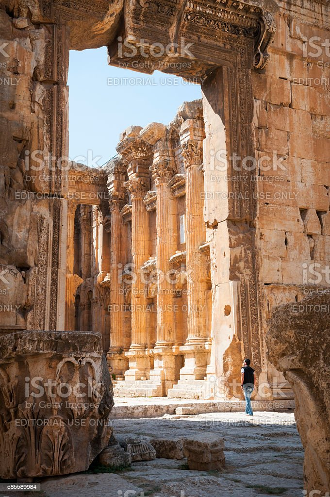 Man at Temple of Bacchus in Baalbek, Lebanon stock photo