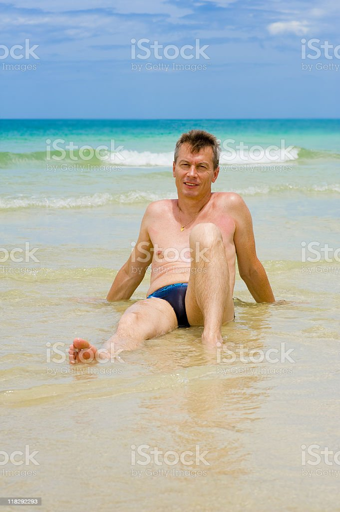 man at the beach stock photo
