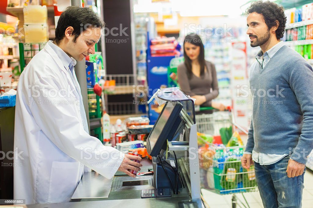 Man at the cashier in a supermaket stock photo