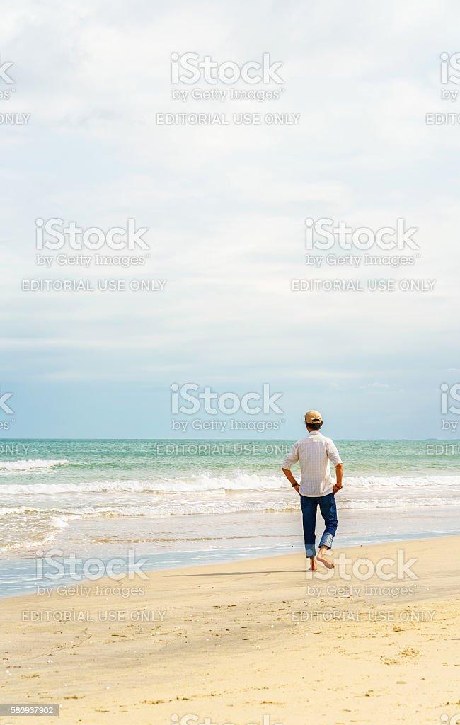 Man at the China Beach in Danang in Vietnam stock photo