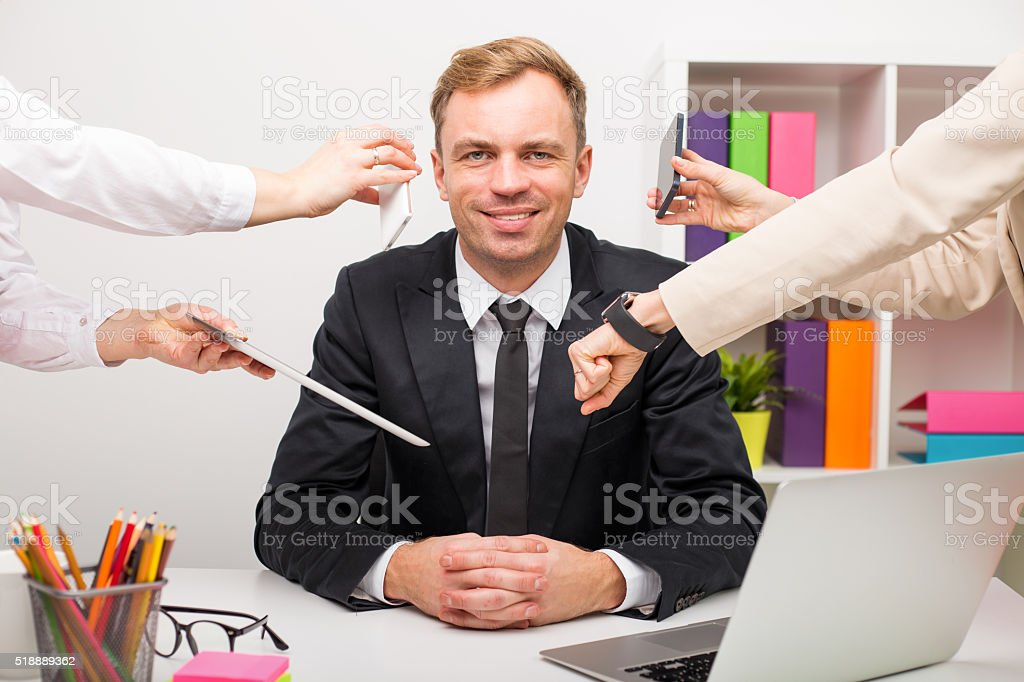 Man at the office having a lot of work stock photo
