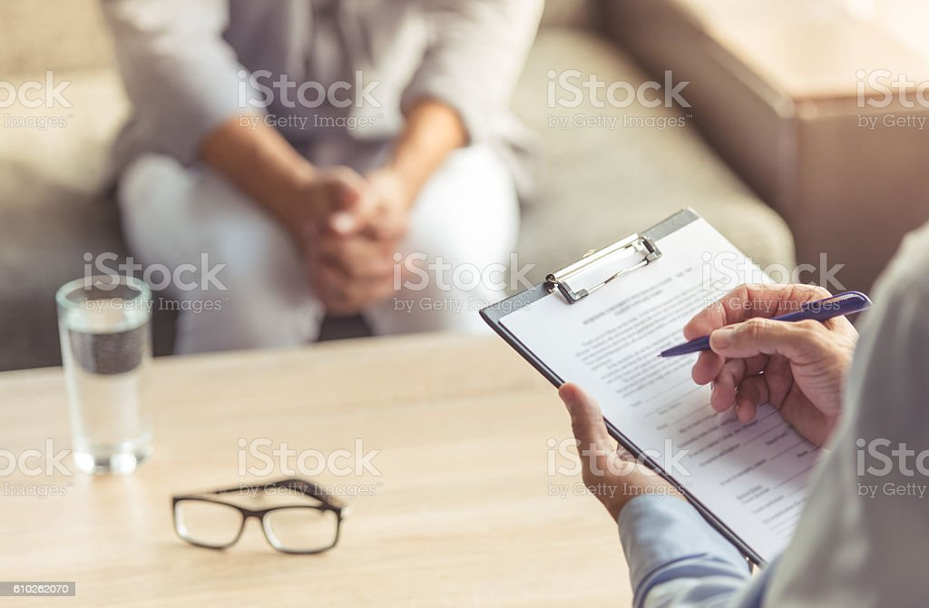 Man at the psychotherapist stock photo