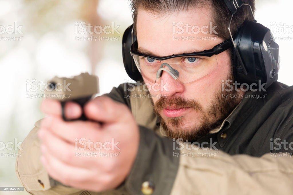 Man at the Shooting Range stock photo