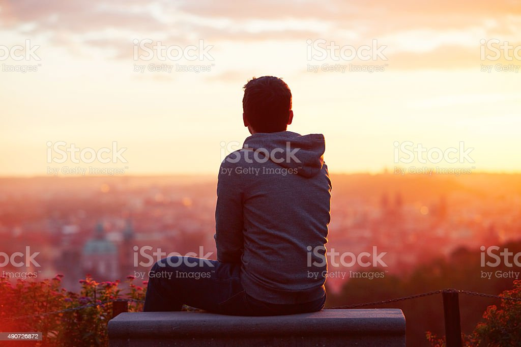 Man at the sunrise stock photo