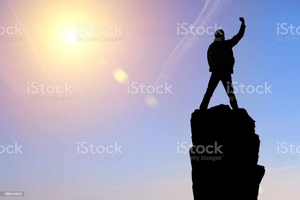 man at the top of the mountain stock photo