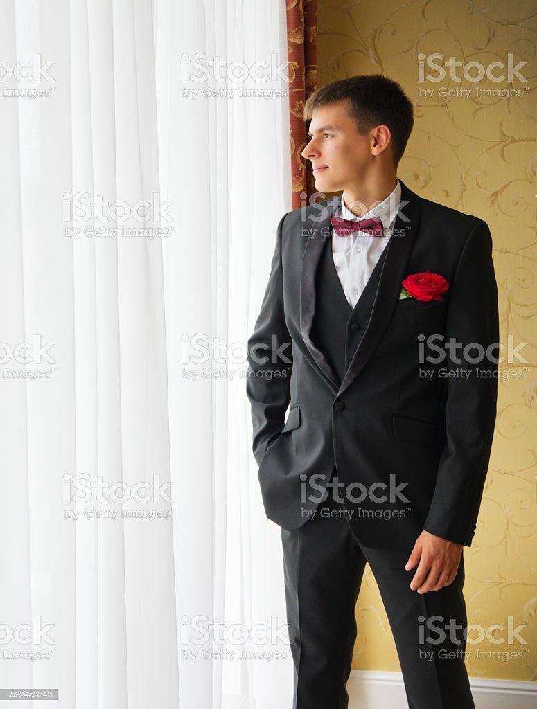 Man at the window stock photo
