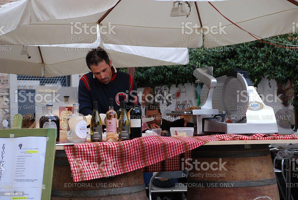 Man at Wine and Ham Stall stock photo