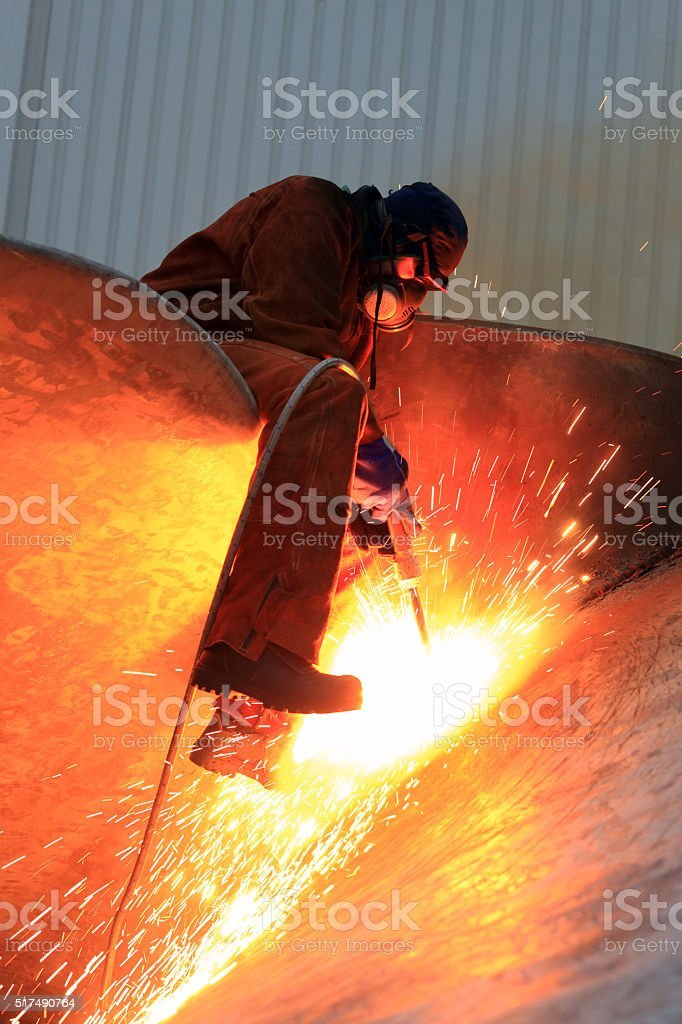 Man at work and sparks stock photo