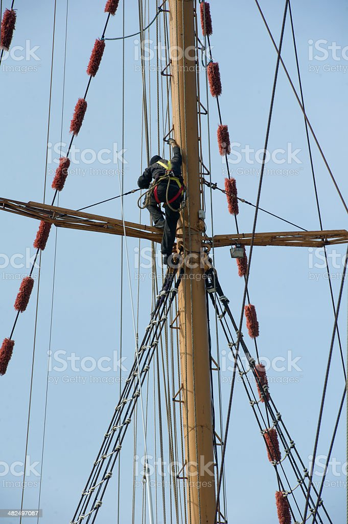 Man at work climbed the shrouds royalty-free stock photo