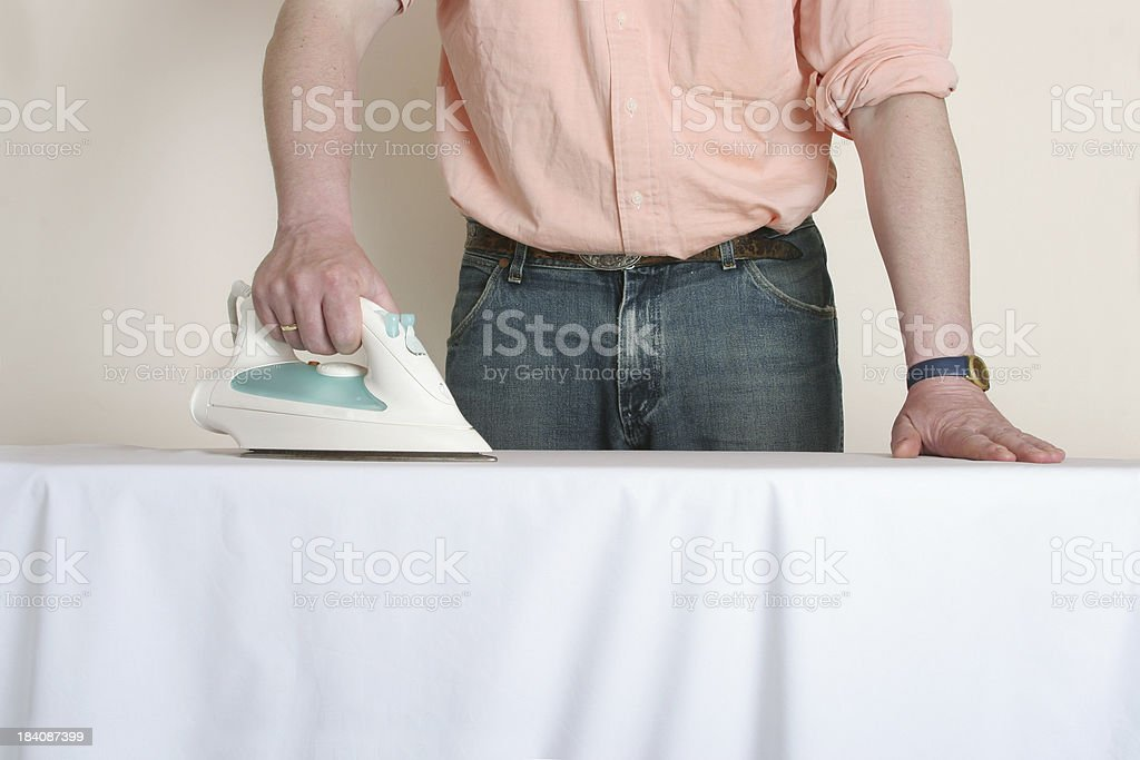man at work, ironing royalty-free stock photo
