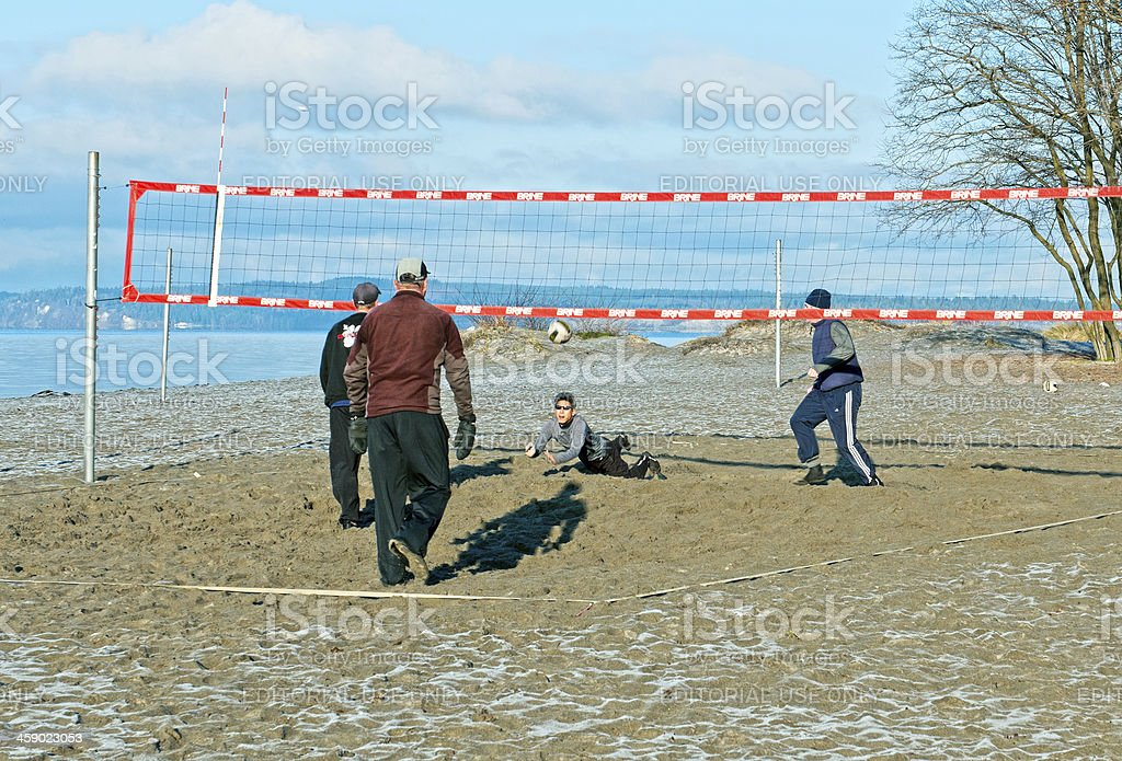 Man attempts diving save in a volleyball game royalty-free stock photo