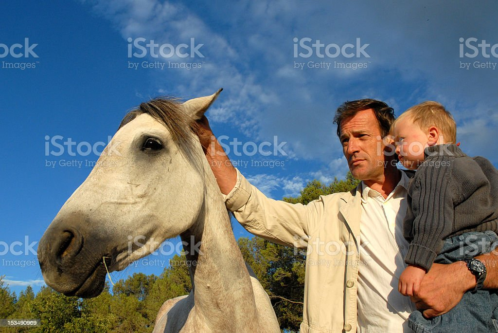 man, baby and horse royalty-free stock photo
