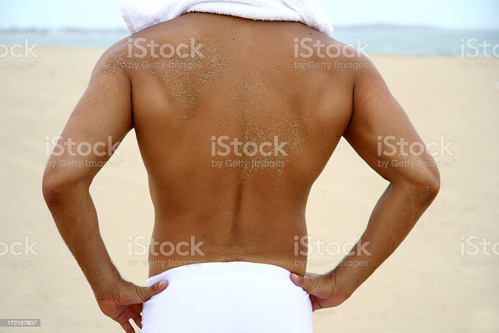 Man Back Sunbathing in a Beach royalty-free stock photo