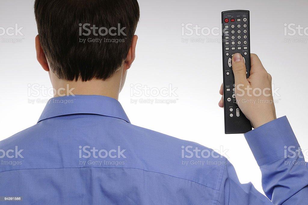 Man back using remote royalty-free stock photo