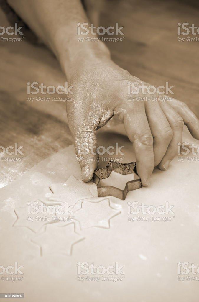 Man baking christmas cookies stock photo