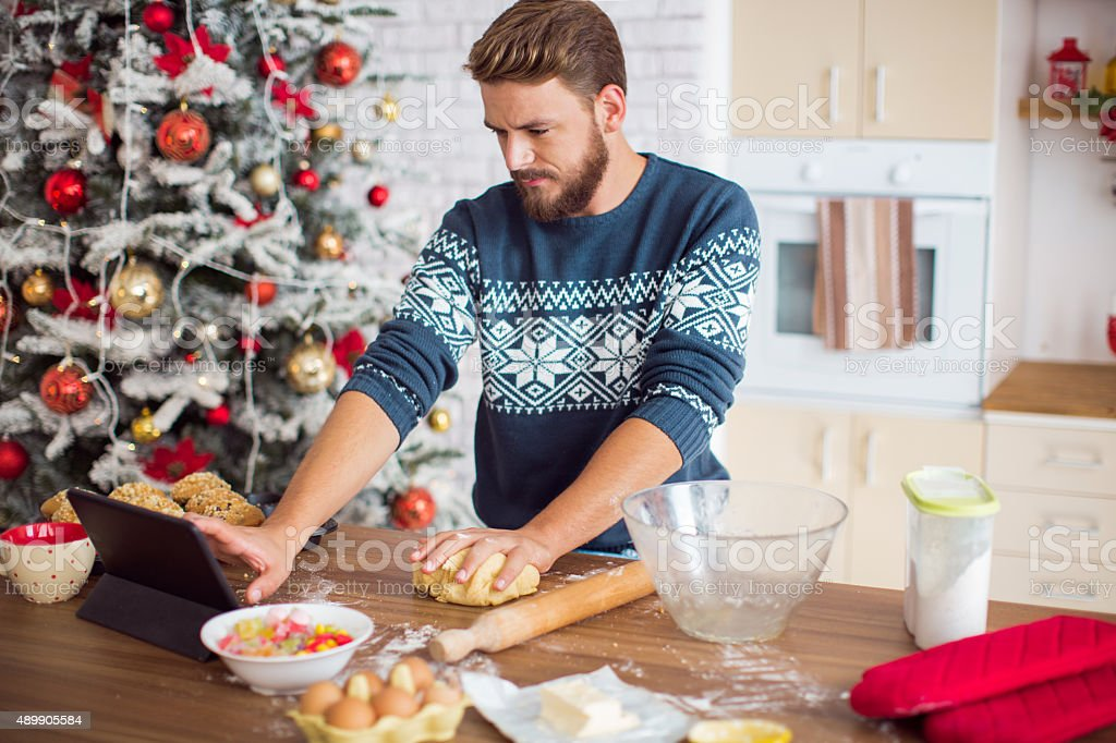 Man baking in kitchen for christmas. stock photo