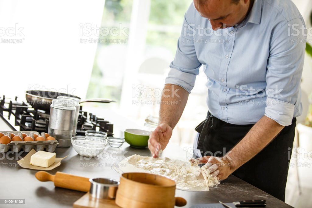 Man baking pizza dough stock photo