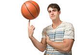 man balance the basketball