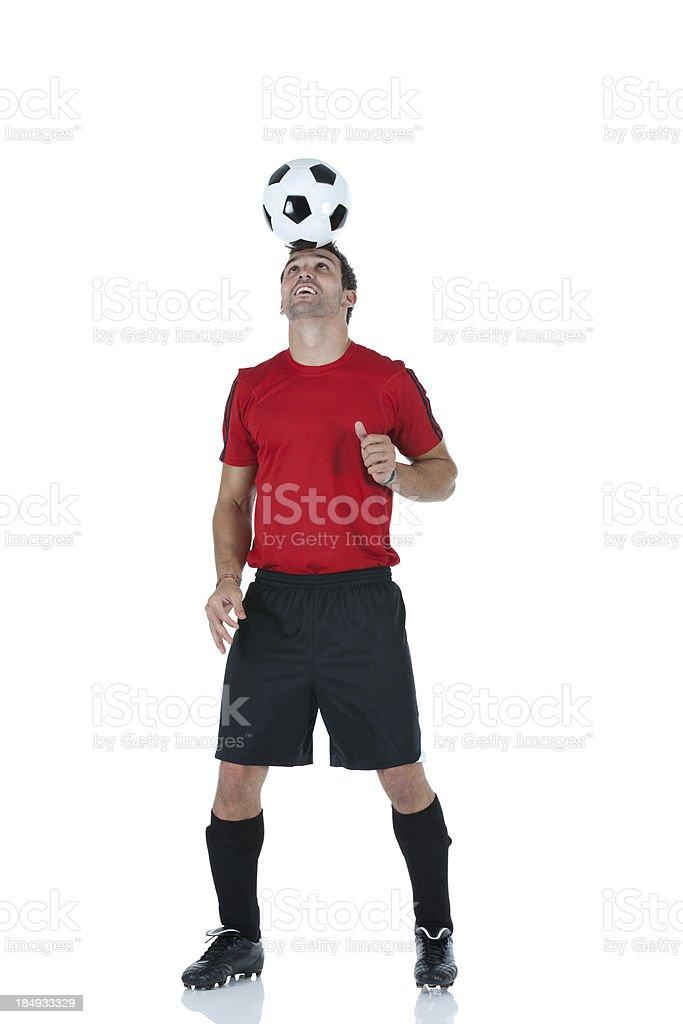 Man balancing a soccer ball on his head royalty-free stock photo