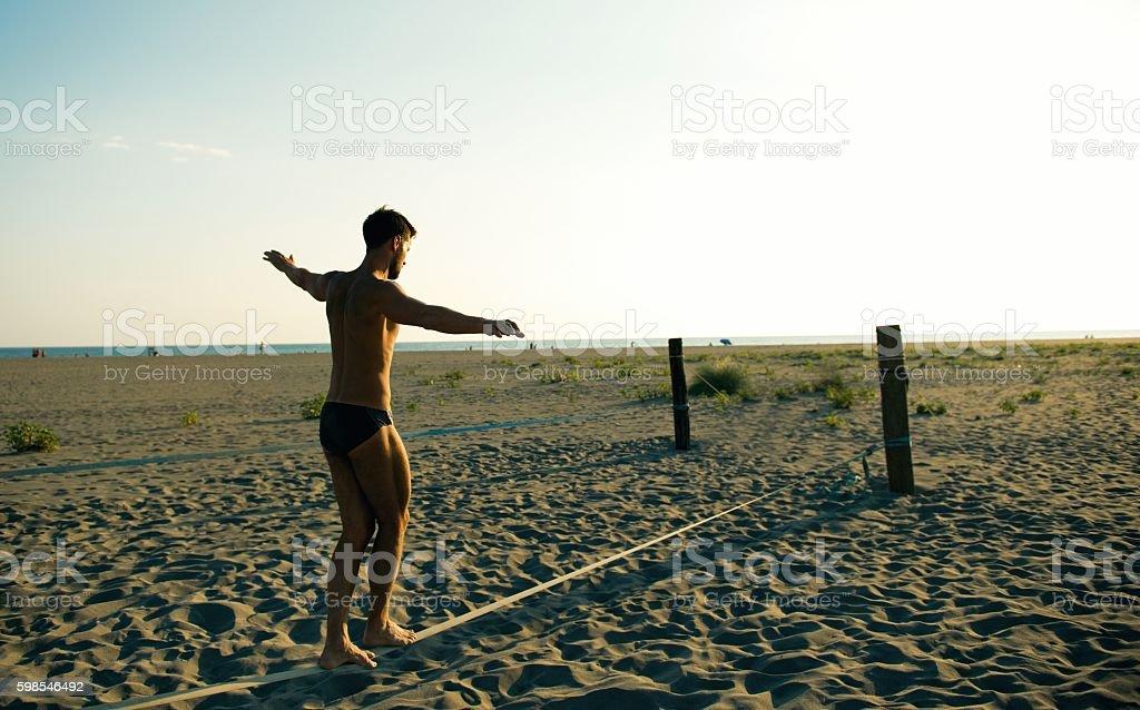 Man balancing on slackline. stock photo