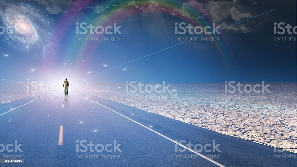 Man bathed in light and roadway stock photo