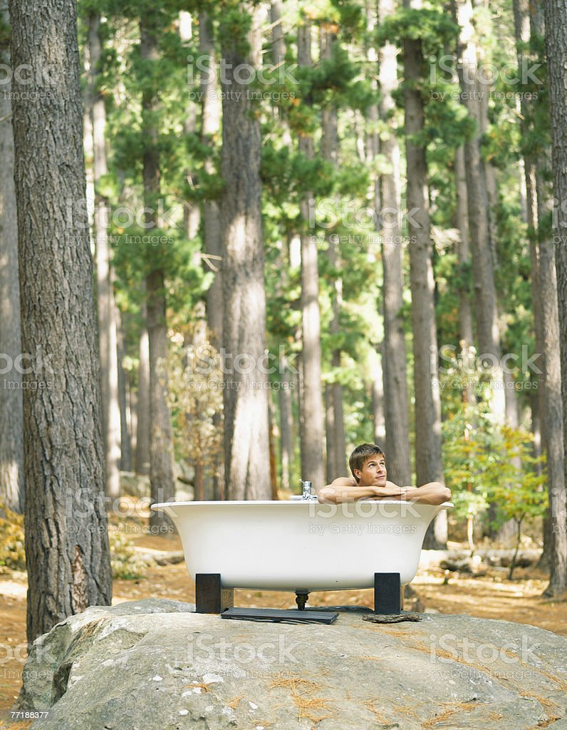 A man bathing outdoors in the woods royalty-free stock photo