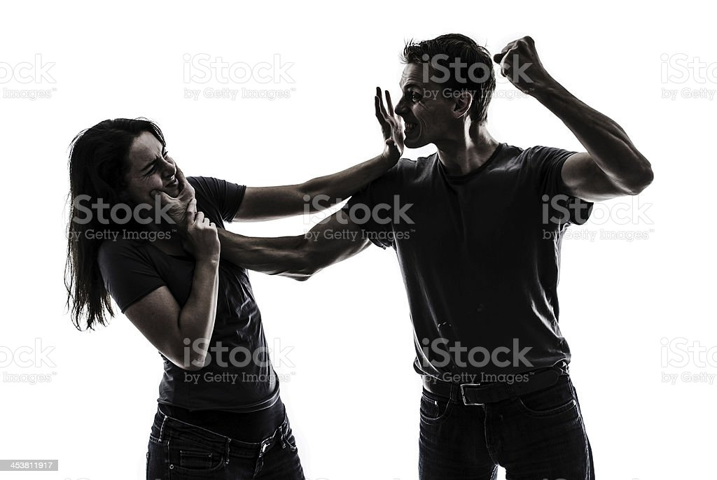 man beating up woman stock photo