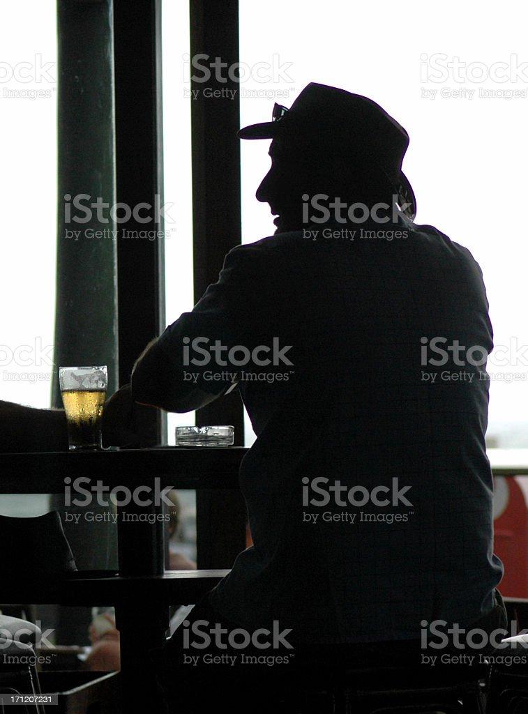 Man, Beer & Ash Tray royalty-free stock photo