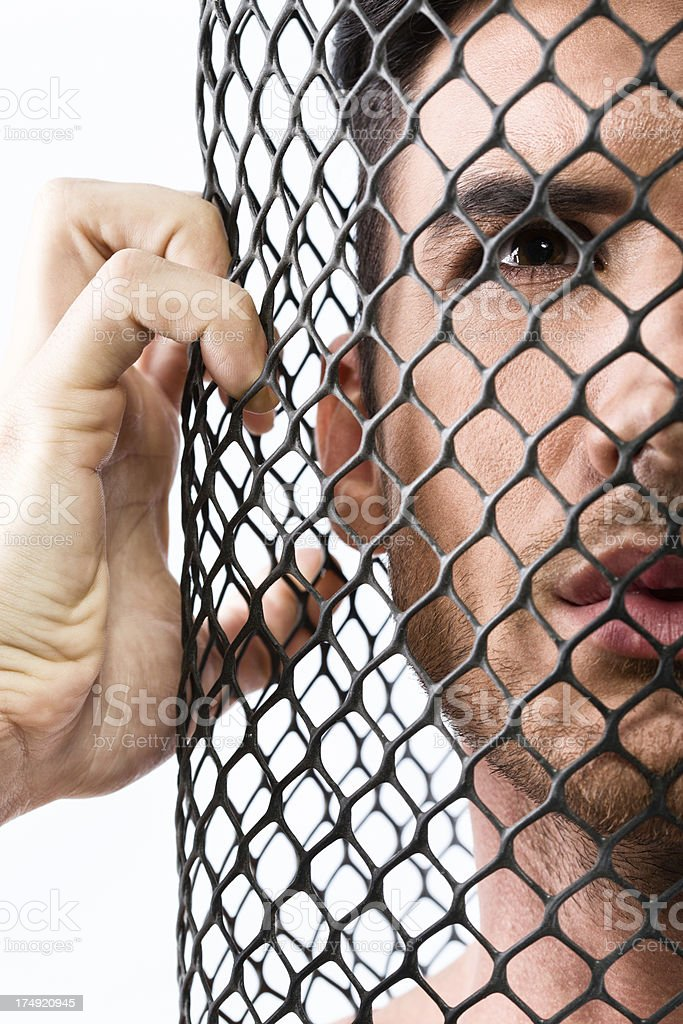 Man behind fence royalty-free stock photo