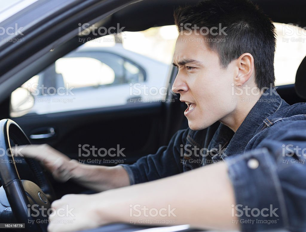 Man behind the steering wheel looking angry royalty-free stock photo