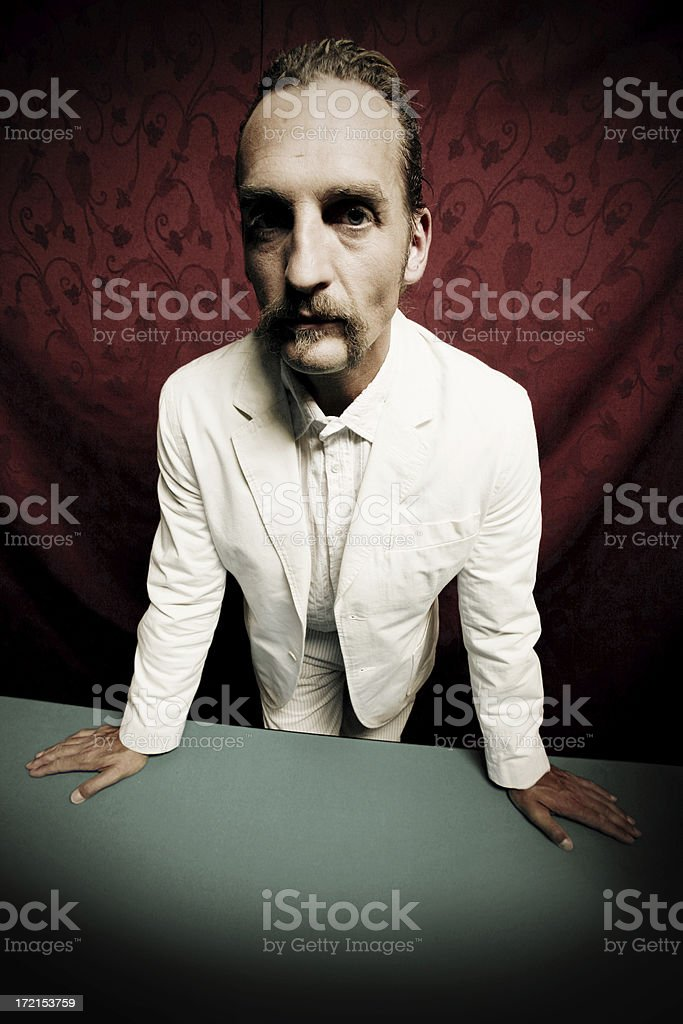 man behind the table royalty-free stock photo