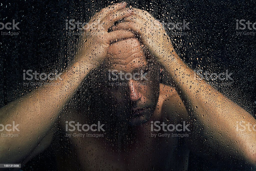 Man Behind Wet Glass royalty-free stock photo