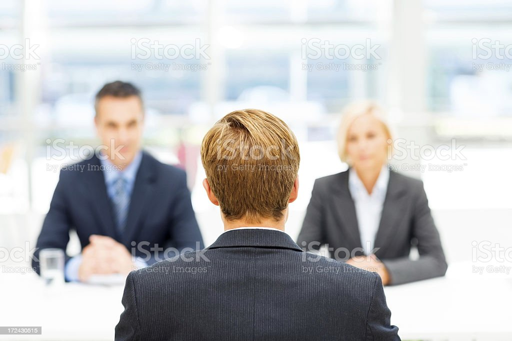 Man Being Interviewed By Professionals royalty-free stock photo