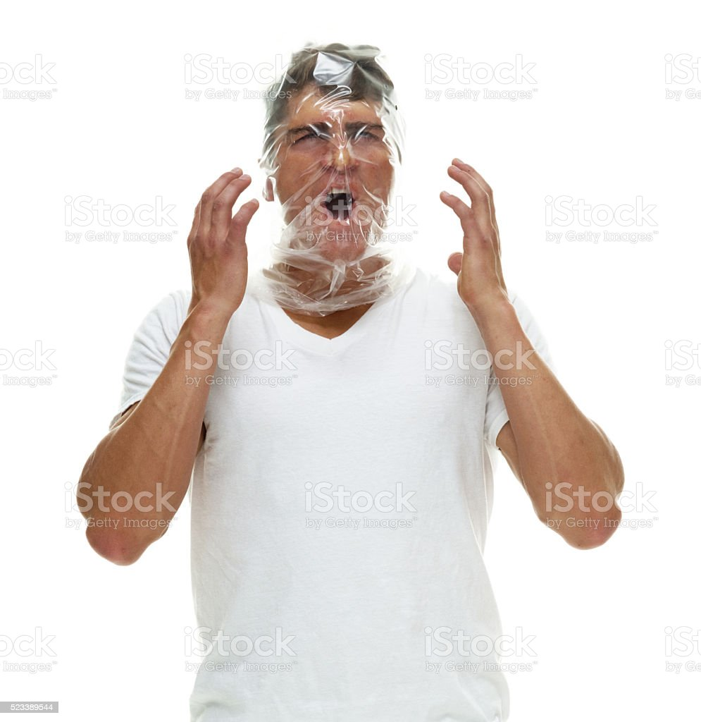 Man being suffocated stock photo