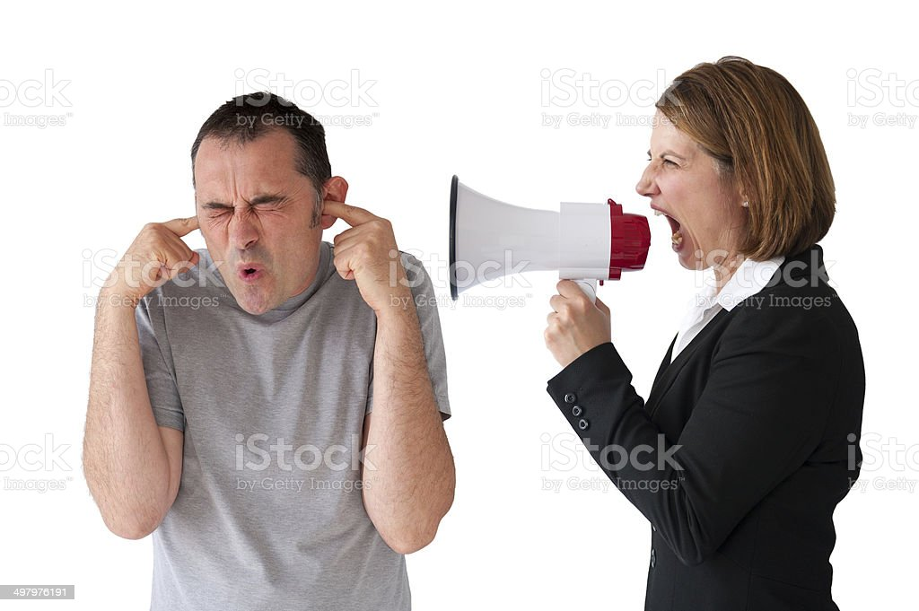 man being yelled at by female manager stock photo