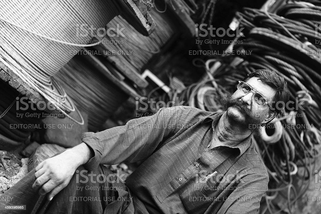 Man Big Mostache, Electric Cable Dealer in Karachi Scrapyard royalty-free stock photo