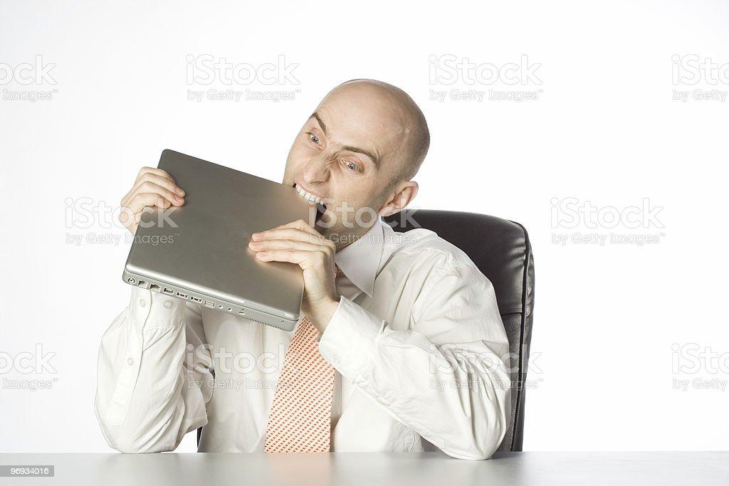 Man Biting Laptop royalty-free stock photo
