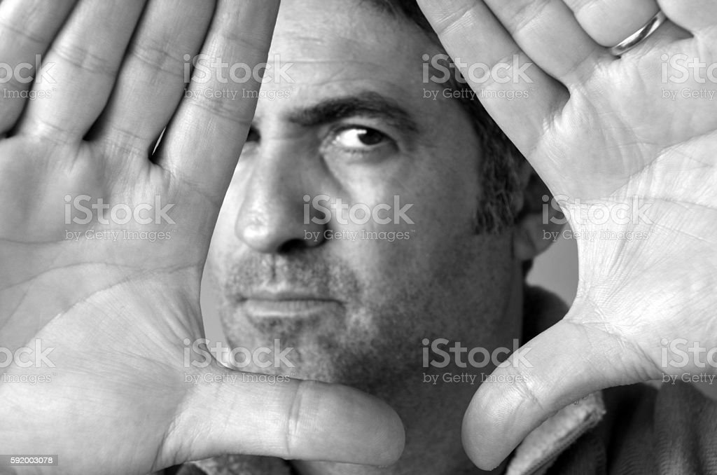 Man blocks with his hands his face stock photo