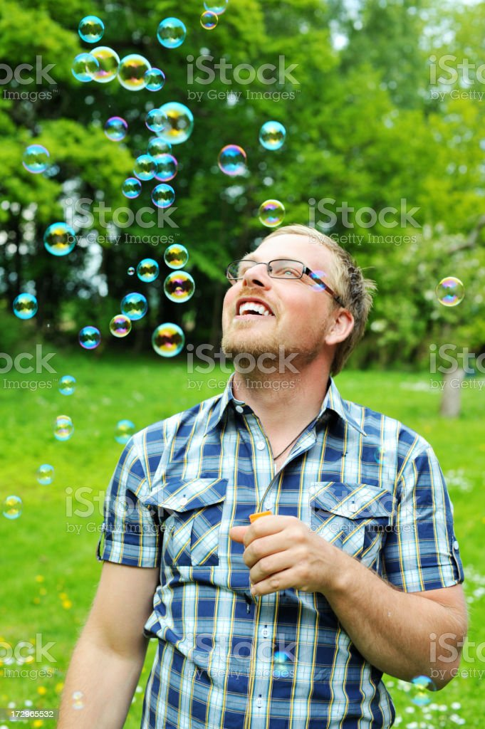 Man blowing bubbles outdoors royalty-free stock photo