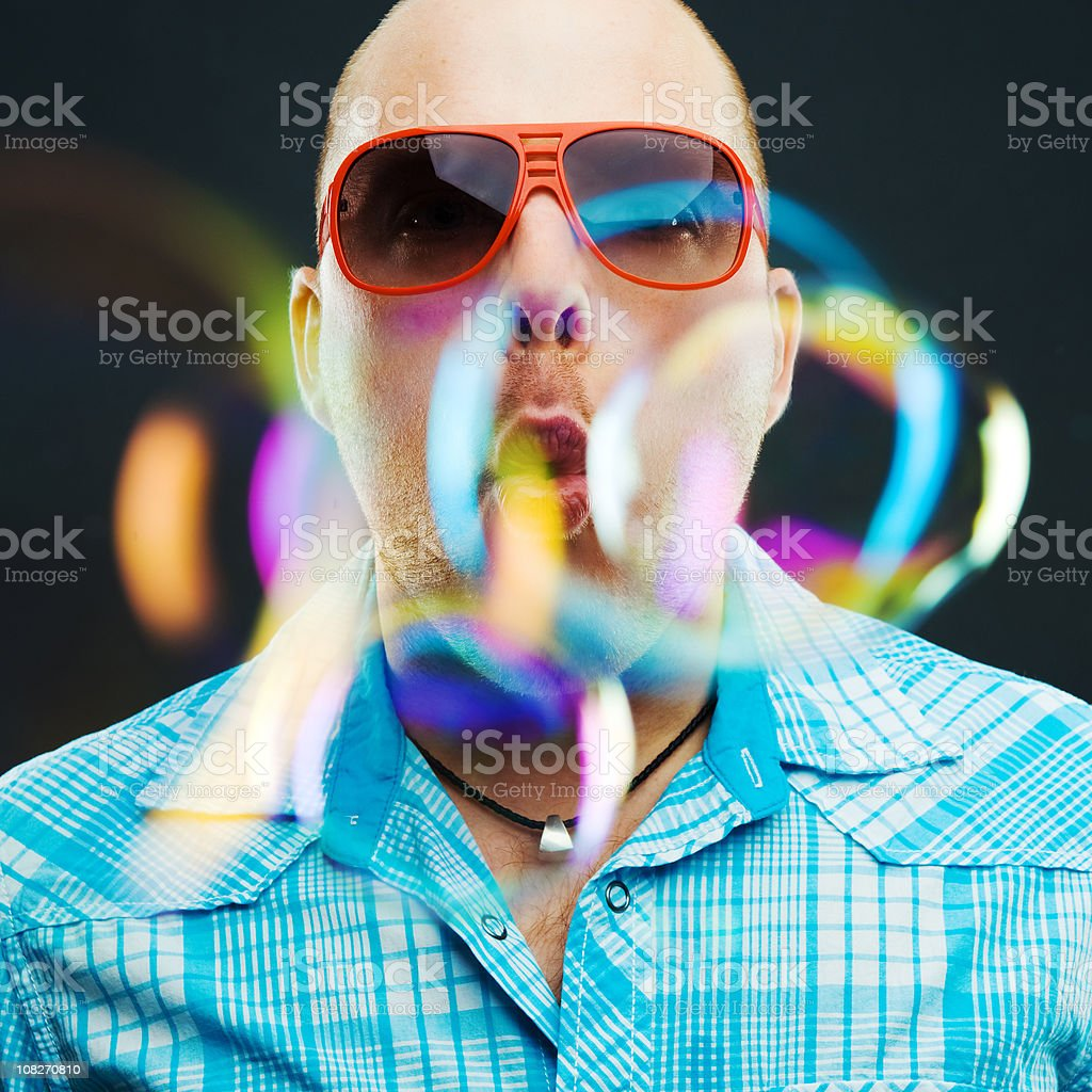 Man Blowing Bubbles royalty-free stock photo