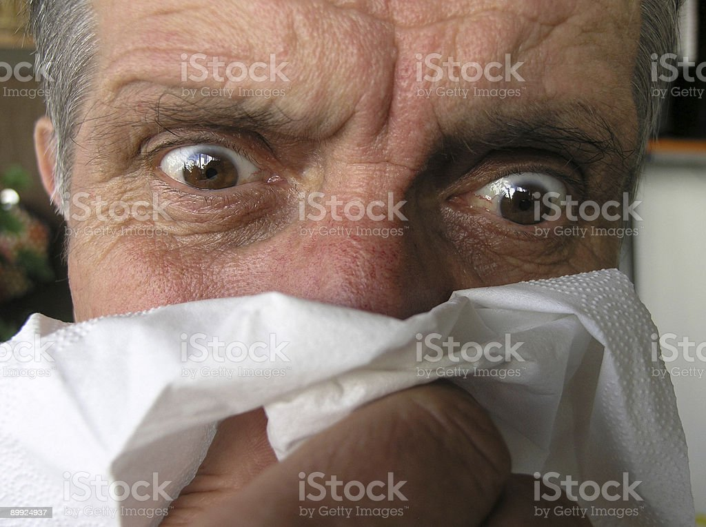 Man blowing his nose  #1 royalty-free stock photo