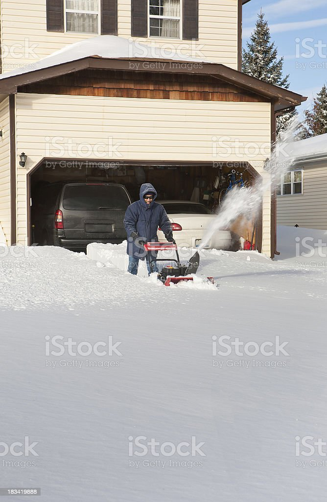 man blowing snow after blizzard wide vert royalty-free stock photo