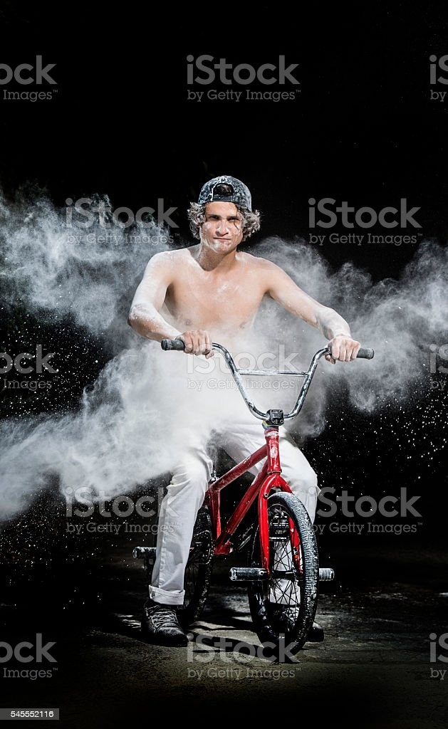 boy posing with bicycle