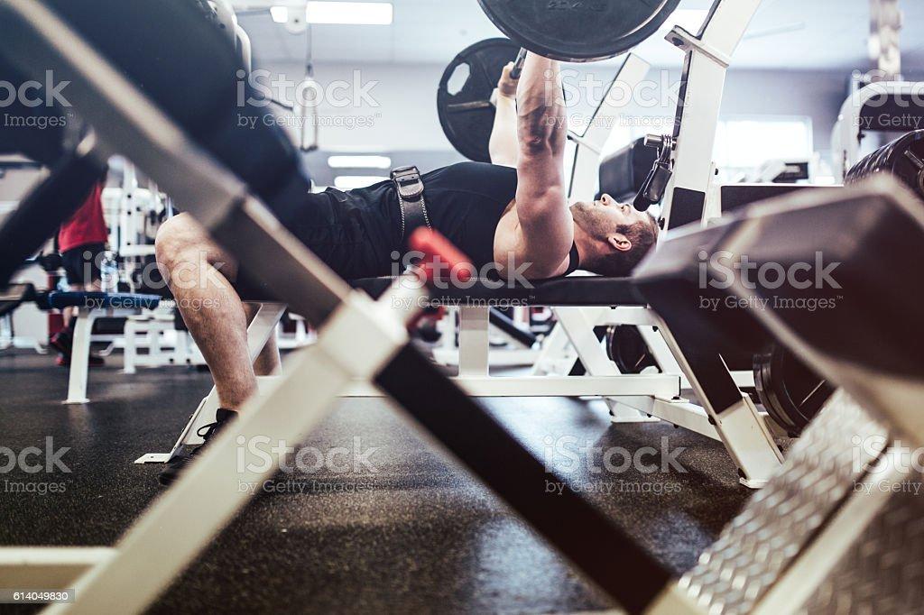 Man Bodybuilding in Gym stock photo