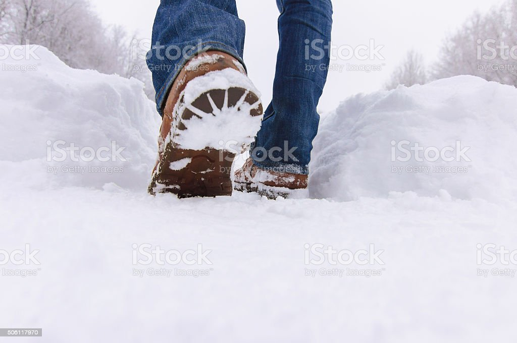 Man boots in the deep snow a winter day. stock photo