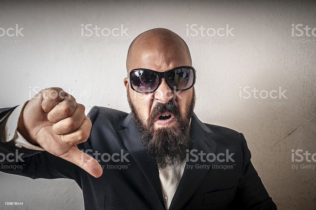 man bouncer with sunglasses and negative expression stock photo