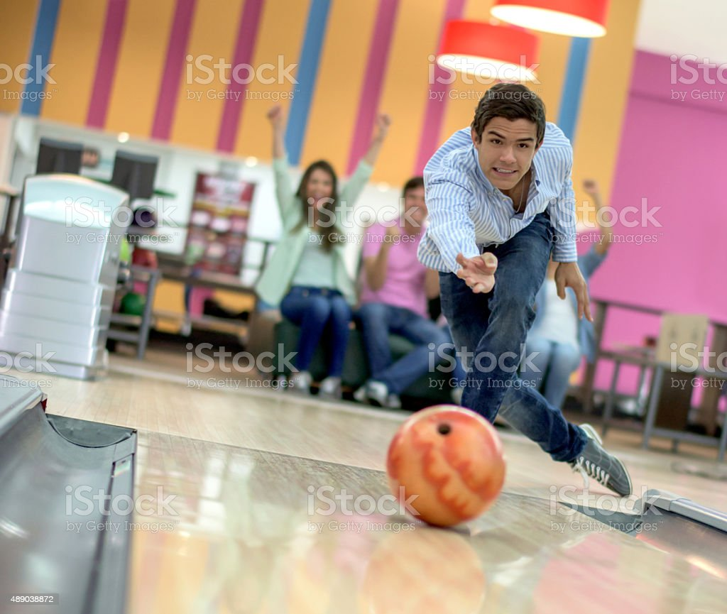 Man bowling with his friends stock photo